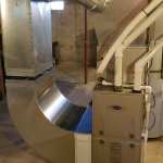 A picture of a residential Carrier furnace installation