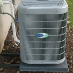 Picture of a Carrier condenser residential install